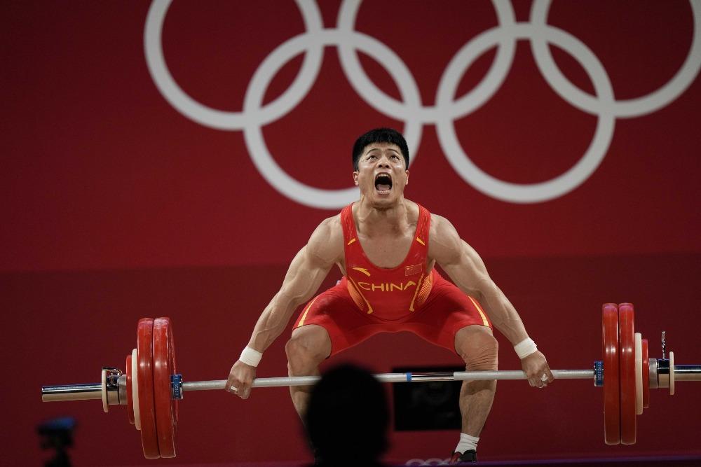 當代中國-體育運動-東京奧運李發斌61公斤級舉重奪冠